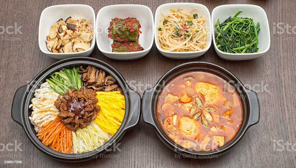 Korean Bibimbap And Kimchi Soup With Side Dishes Stock Photo Download Image Now Istock