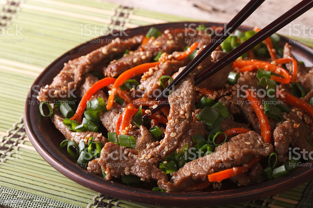 Korean bulgogi beef with carrot and onion closeup. horizontal stock photo