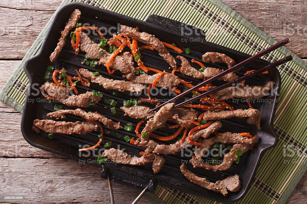 Korean bulgogi beef with carrot on grill. horizontal top view stock photo