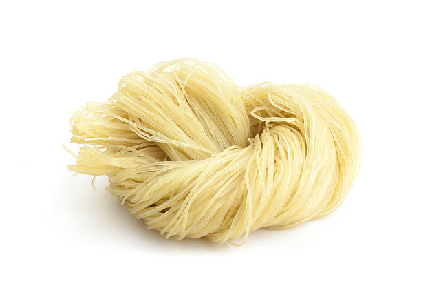 Korean Cold Noodle Cold Noodle is a common food of  Korean,isolated on white background. rice noodles stock pictures, royalty-free photos & images