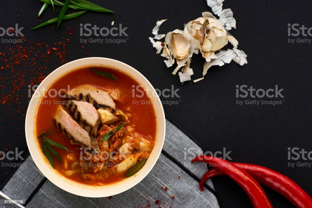 Korean cuisine. Kimchi soup on black background photo libre de droits