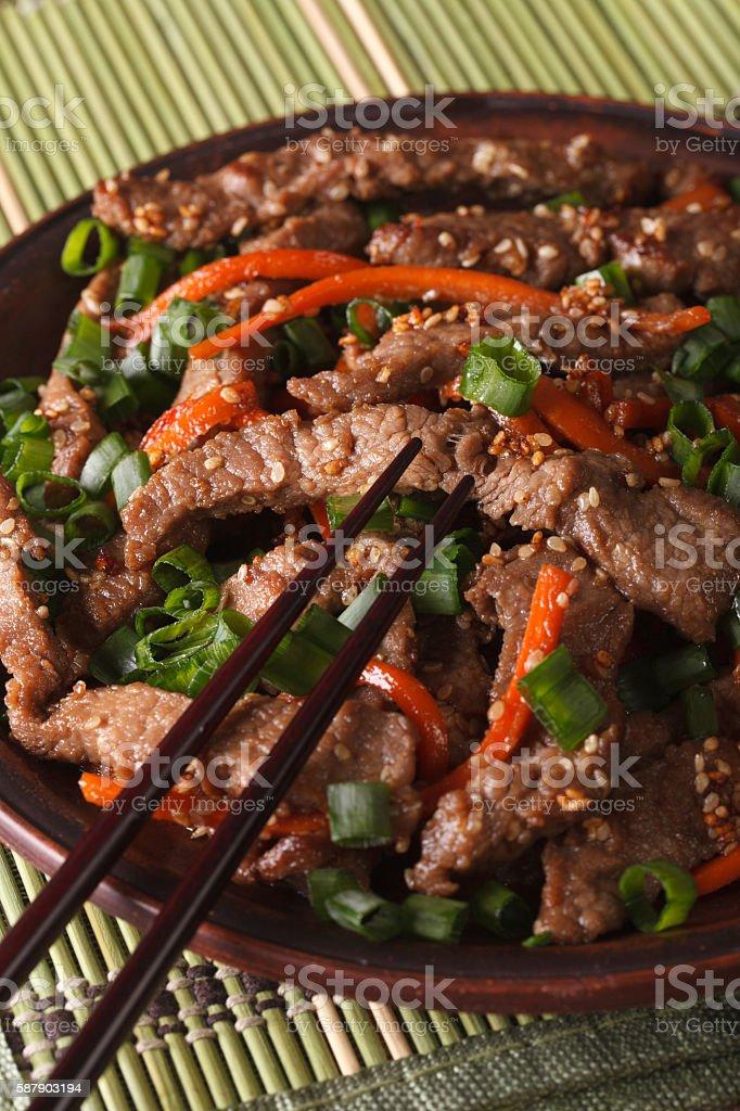 Korean Food: Bulgogi beef with carrot and onion closeup. vertical stock photo
