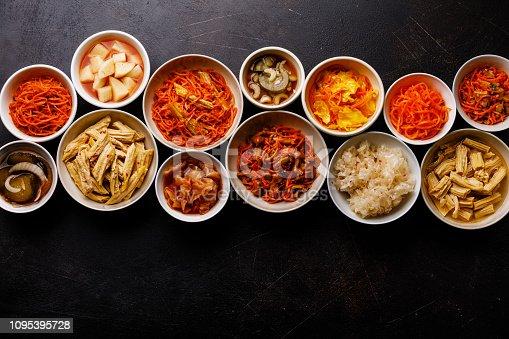Korean food Pickled vegetables and Hot salads on dark background copy space