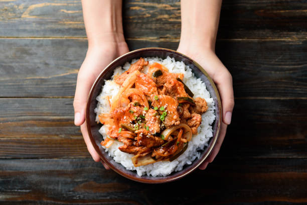 Korean food, Stir fried kimchi with pork and rice stock photo