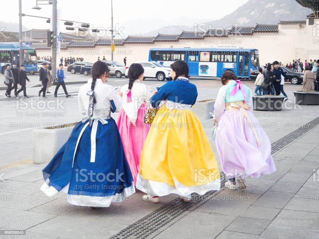 SEOUL, KOREA - MAR. 18, 2017: Korean Girls dressed Hanbok in traditional dress walking stock photo