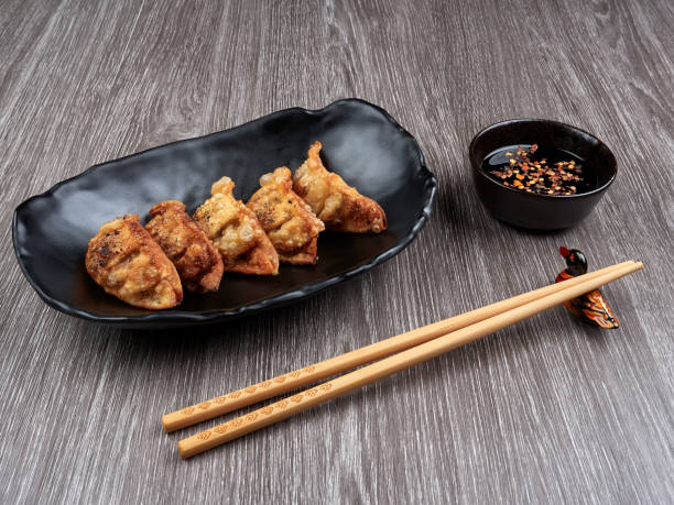 Korean gyoza or fried dumplings snack with soy sauce stock photo