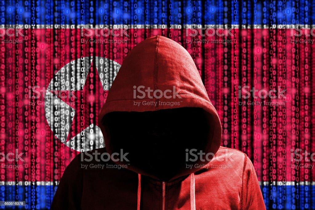 Korean hacker in front of digital datastream flag stock photo