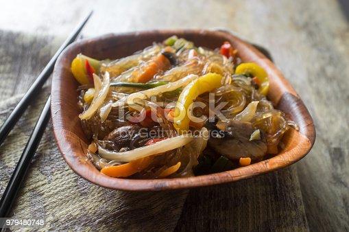 Korean Japchae vegetarian stir fried cellophane noodles with vegetablesKorean Japchae vegetarian stir fried cellophane noodles with vegetables