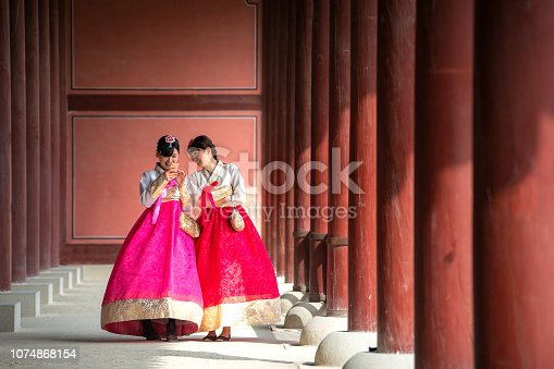 istock Korean lady in Hanbok or Korea gress and walk in an ancient town 1074868154