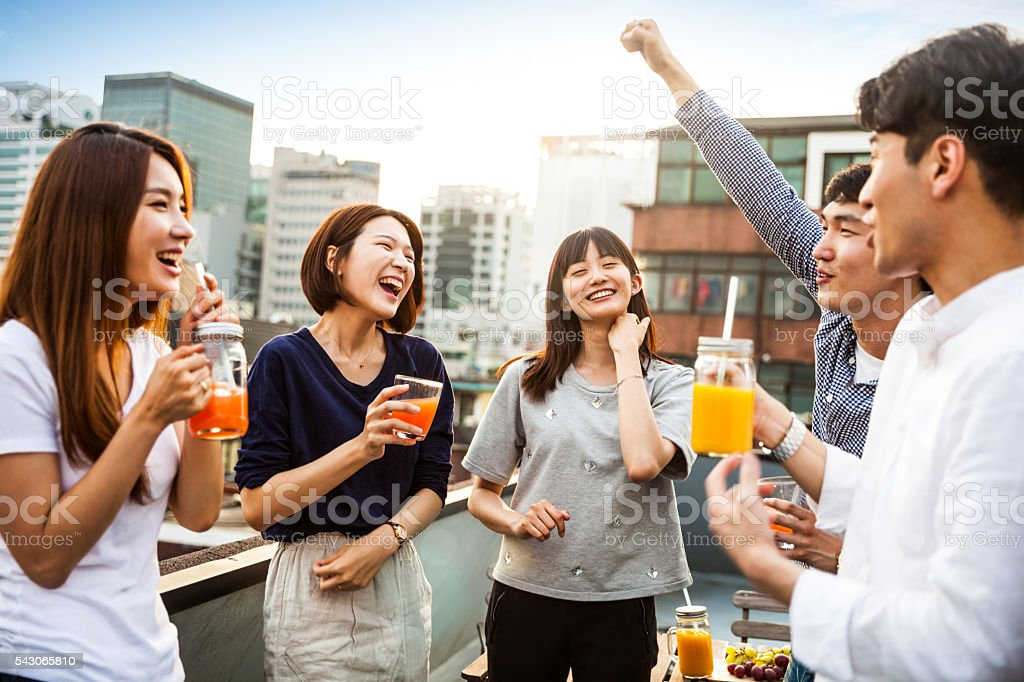 Korean people having rooftop party in Seoul stock photo