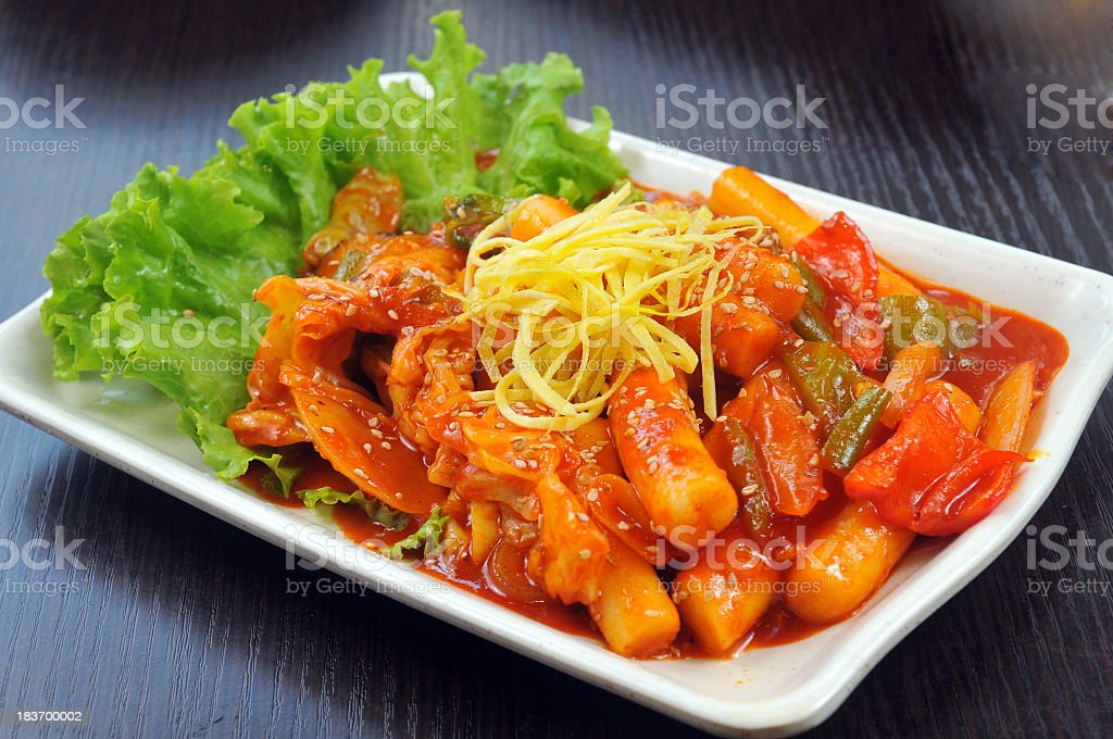Korean plate of food with orange sauce and lettuce stock photo