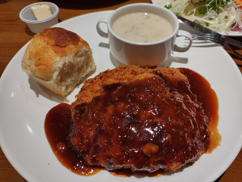Korean pork cutlet with bread and soup
