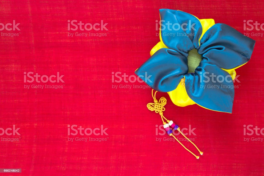 Korean traditional bag & knot background of red ramie fabric. stock photo