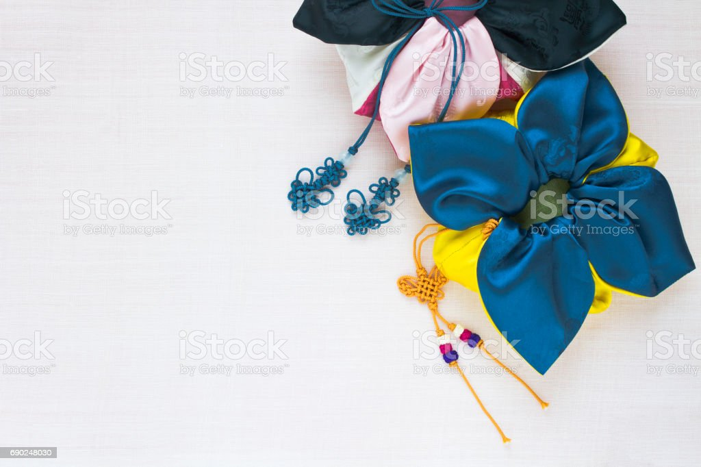Korean traditional bag & knot background of white ramie fabric. stock photo