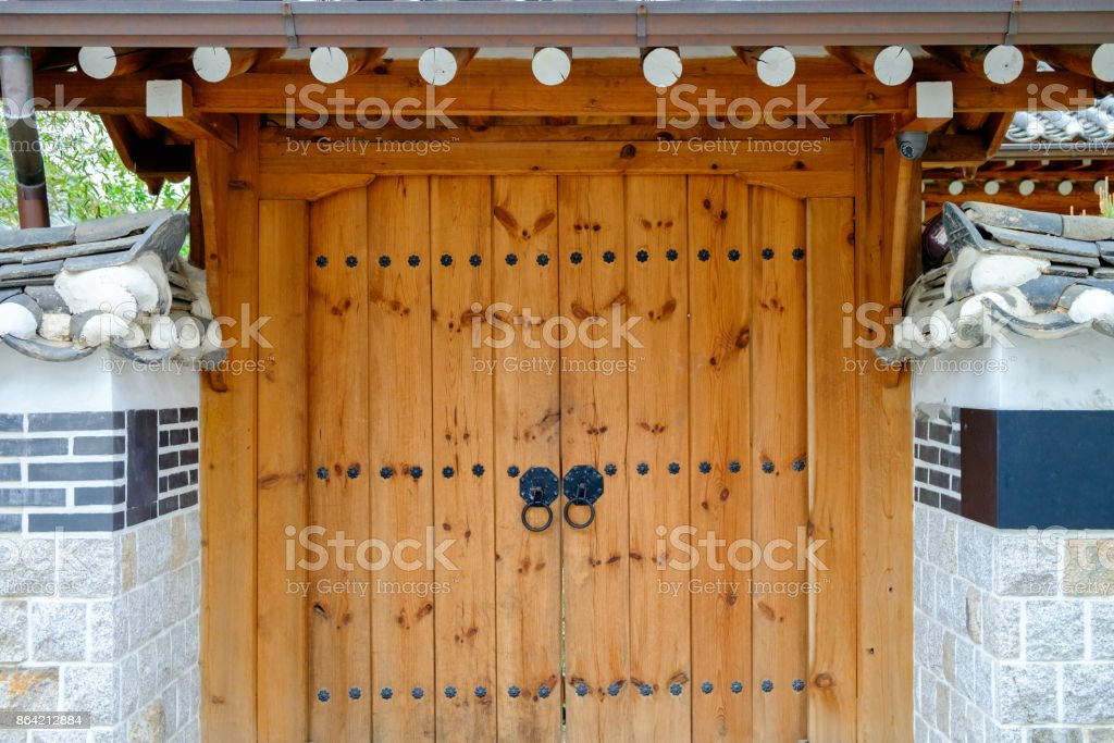 Korean traditional door with walls made of cement royalty-free stock photo