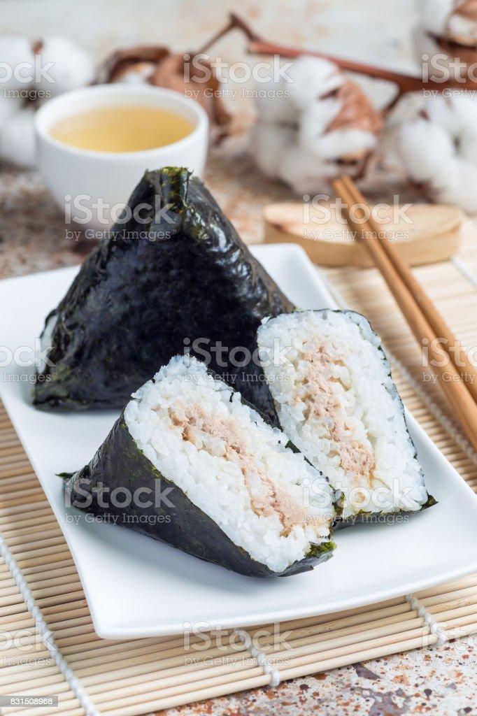 Korean triangle kimbap Samgak with nori, rice and tuna fish, similar to Japanese rice ball onigiri. Vertical stock photo