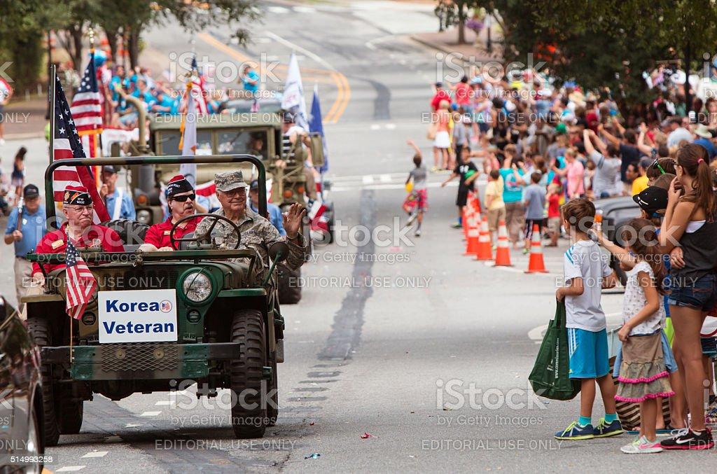 Korean War Veteran Waves During Old Soldiers Day Parade stock photo