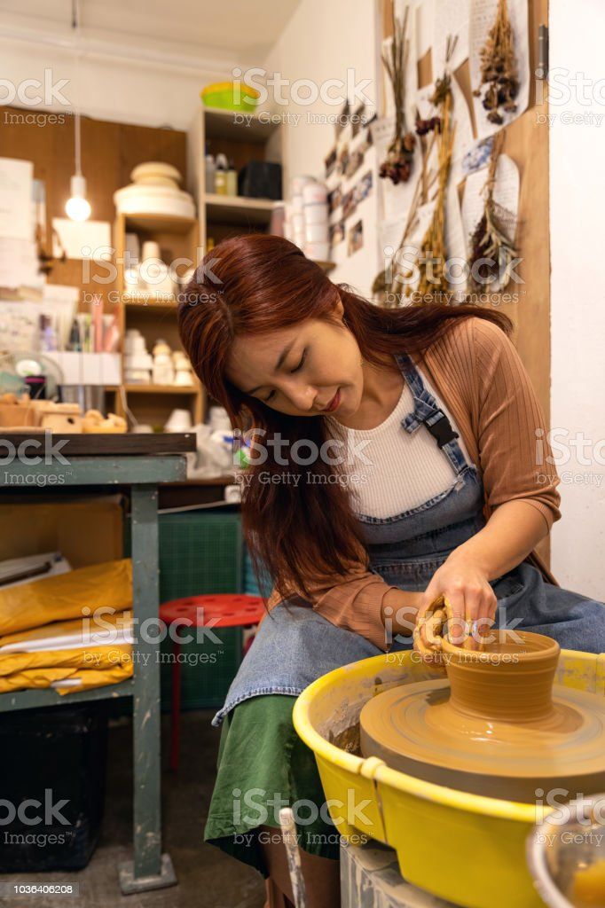 Korean woman artist working in her studio in Seoul stock photo