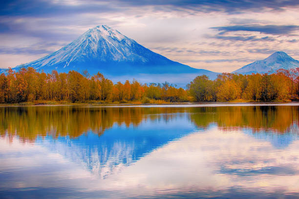 Koryaksky volcano and the reflection in the lake Scenic view of  the Koryaksky volcano and the reflection in the lake kamchatka peninsula stock pictures, royalty-free photos & images