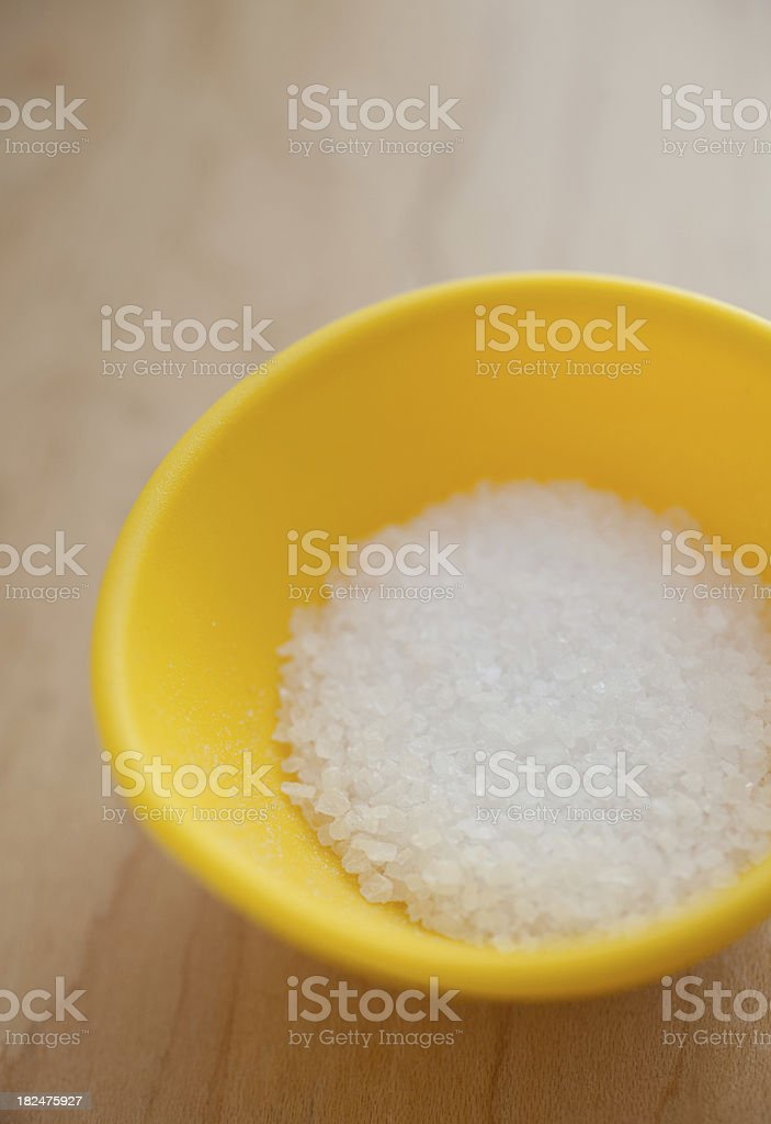 Kosher Sea Salt Grounded in a Yellow Bowl royalty-free stock photo