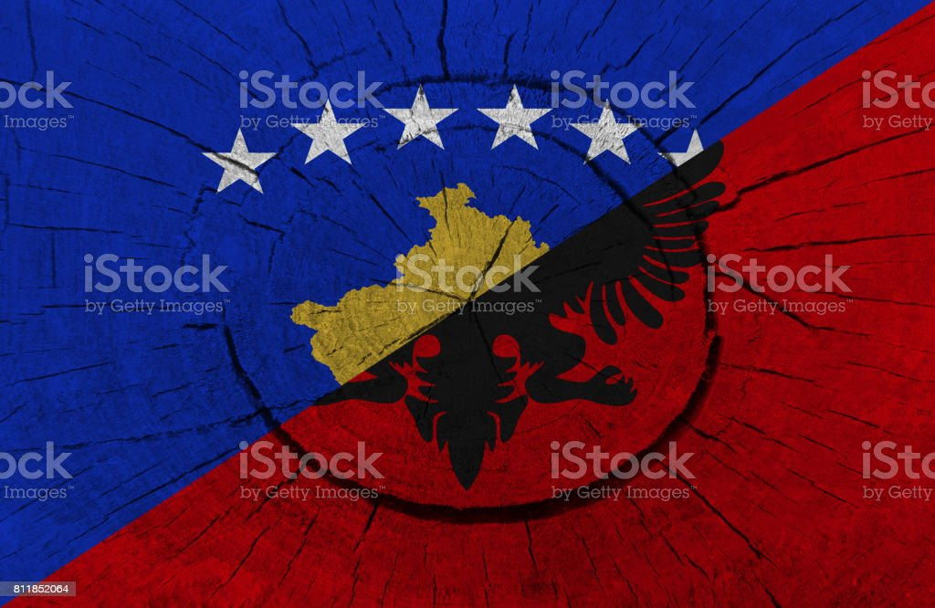 Kosovo and Albanian flag painted on a tree stump stock photo
