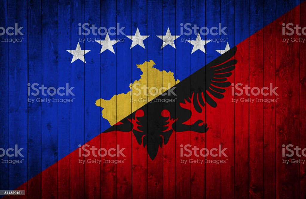 Kosovo and Albanian flag painted on a wooden surface stock photo