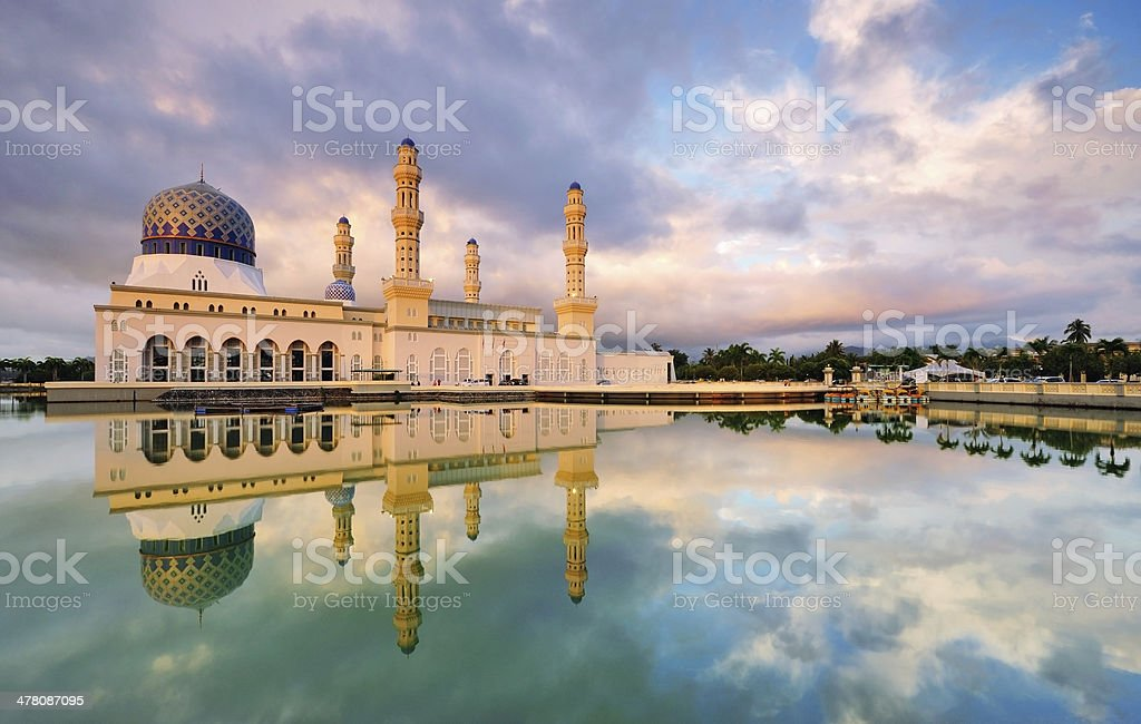 Kota Kinabalu Floating Mosque with Dramatic Clouds and Reflection. stock photo
