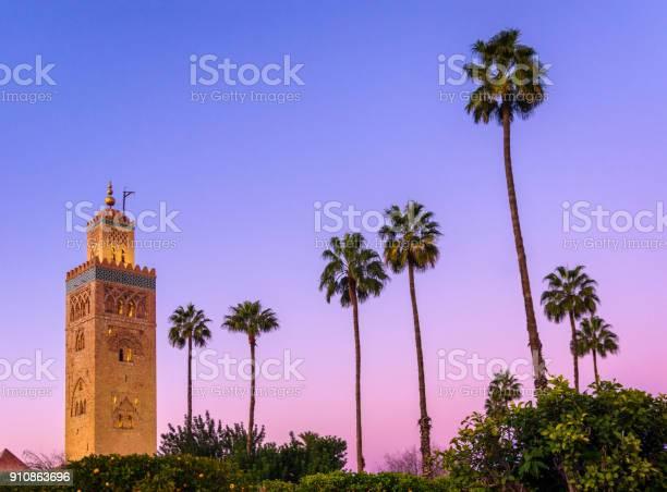 Photo of koutoubia minaret mosque marrakech stock photo blue hour palm tree