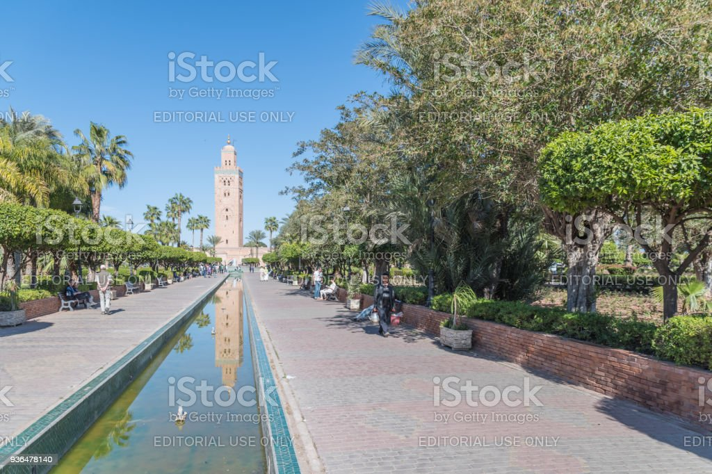Koutoubia Mosque reflected in stream in Marrakesh stock photo
