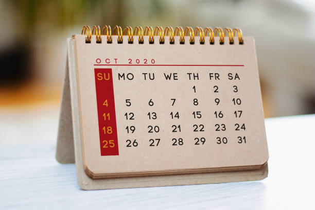 Kraft October calendar is on the table. stock photo