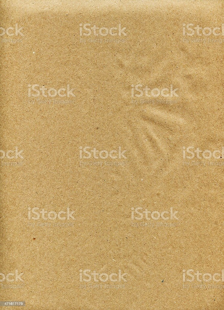 Kraft paper brown with black and white speckles. Smooth surface. royalty-free stock photo