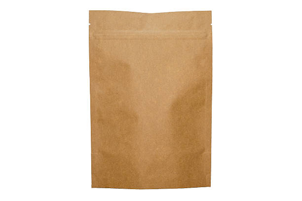 kraft paper doypack bag with zipper on white background stock photo