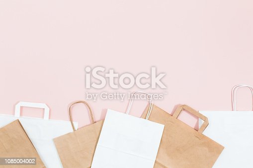 Kraft paper eco bag, top view and flat lay. Brown and white Kraft package with copy space for mock up