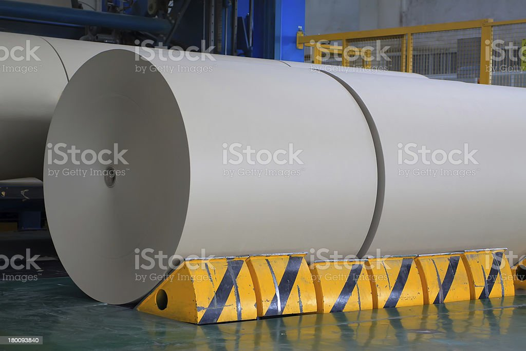 kraft paper roll in the production line stock photo