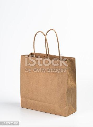 Kraft paper shopping bag on white background