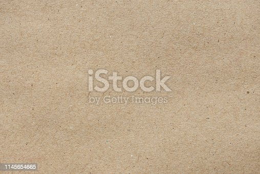 Close up old brown paper texture for background. Kraft paper texture
