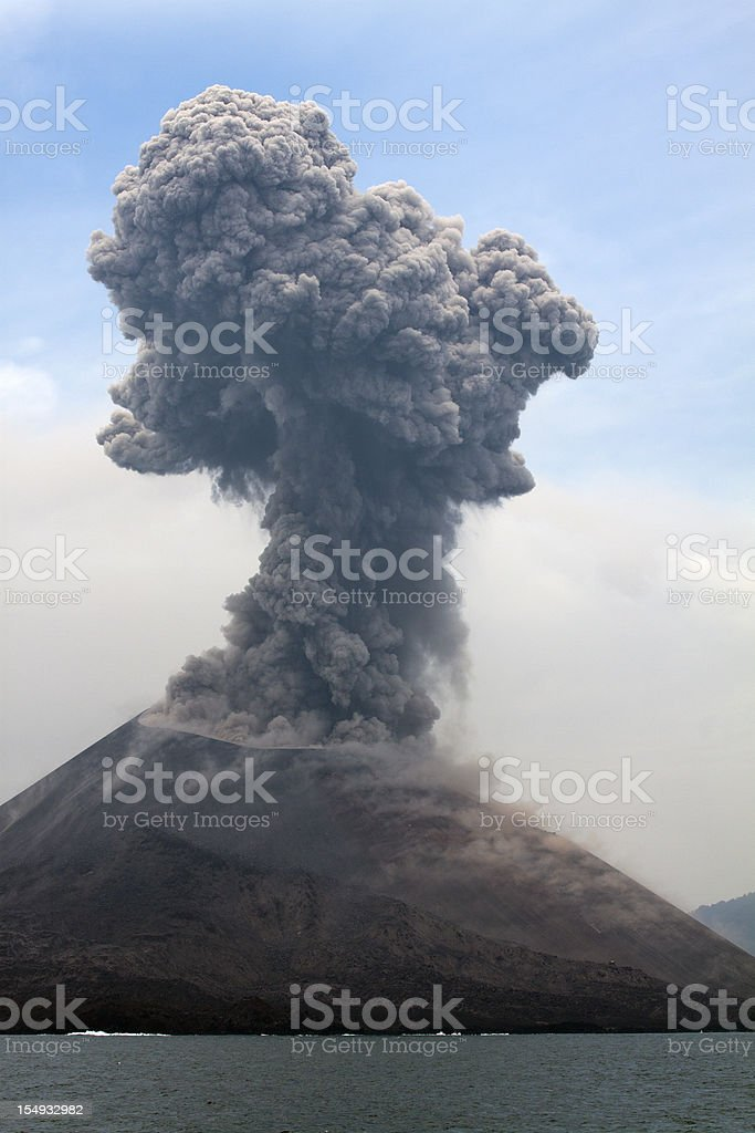 Krakatau erupts plume of smoke stock photo