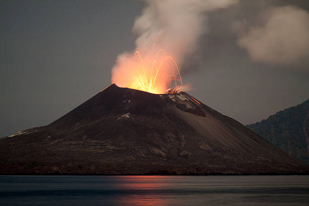 Krakatau Volcano erupting at night - November 2011  volcano stock pictures, royalty-free photos & images