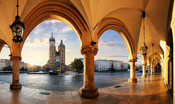 krakow at sunrise, poland. - poland stock photos and pictures