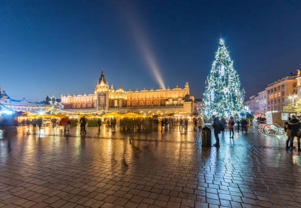 Krakow Main Market Square with Christmas Tree and Cloth Hall time lapse stock photo