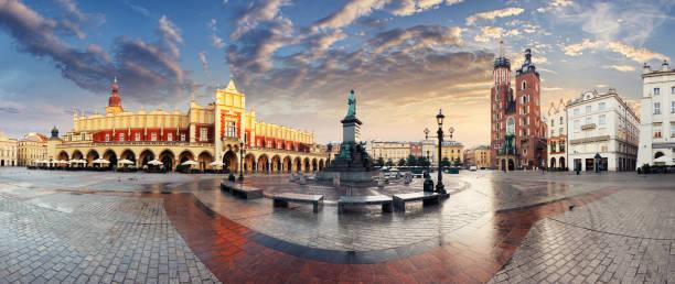krakow market square, poland - panorama - poland stock photos and pictures