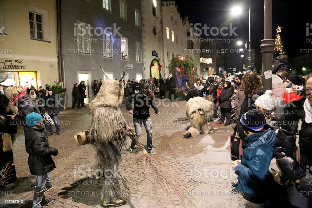 Krampus fighting in the street stock photo