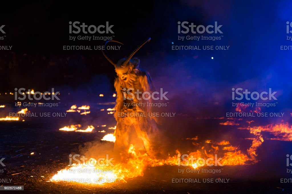 Krampus walking on fire stock photo
