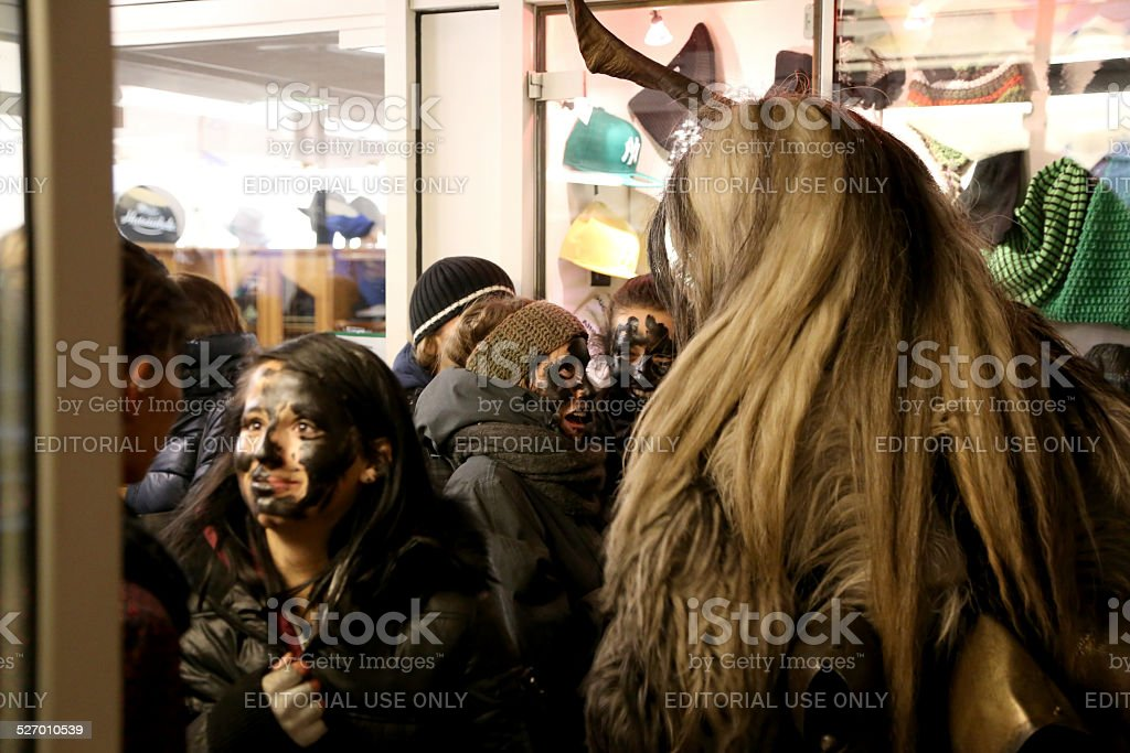 Krampus with frightened girls stock photo