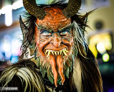 Bad Toelz, Germany - December 7: participant of a traditional pageant called krampuslauf with fantasy costumes and handmade wooden masks on December 7, 2019 in Bad Toelz, Germany
