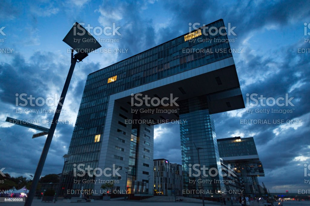 Kranhaus area with impressive buildings in Cologne with dramatic night sky background stock photo