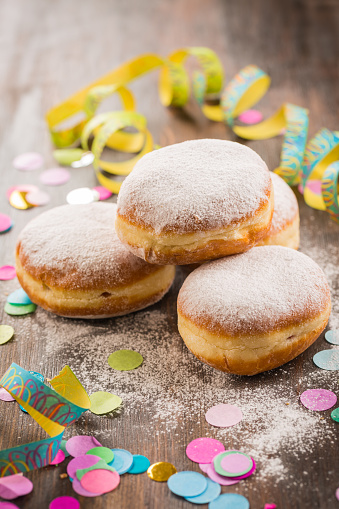 istock Krapfen, Berliner or  donuts with streamers and confetti. Colorful carnival or birthday image 1125077381