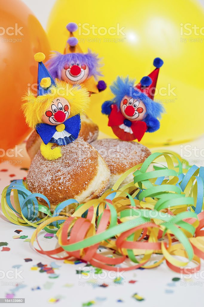 Krapfen or donuts with clowns and streamer royalty-free stock photo