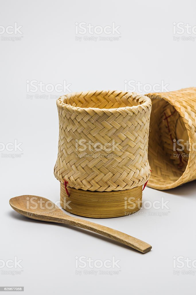 Kratip or Wicker, bamboo container rice white background. stock photo