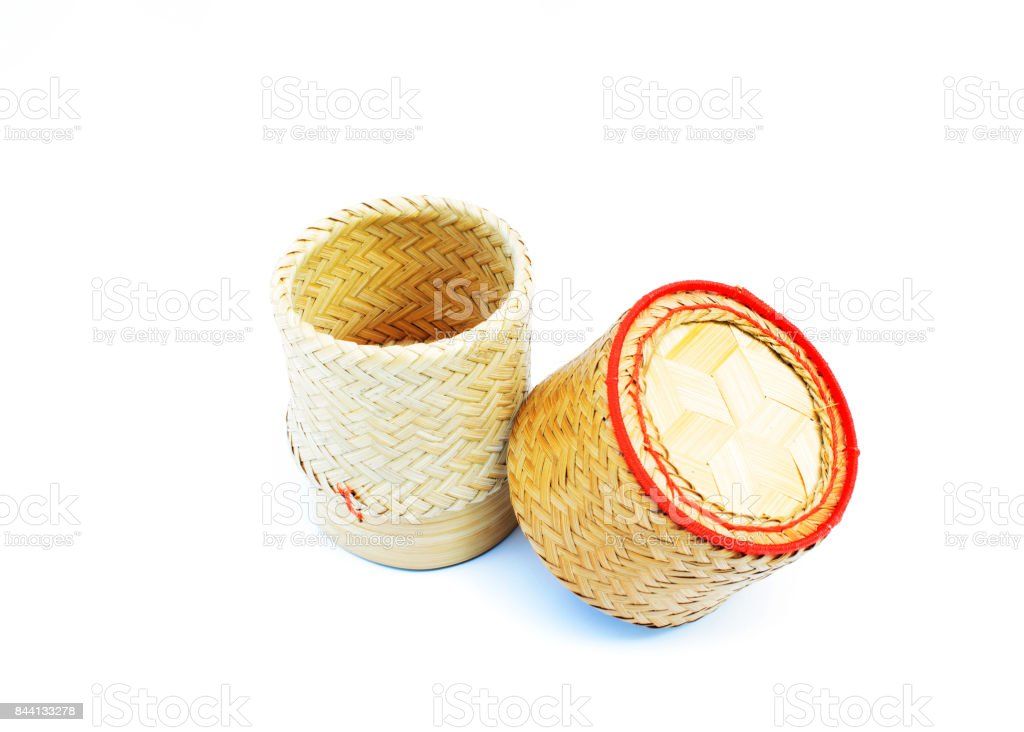 Kratip rice - Bamboo basket of Thai homemade for keep sticky rice on white backgrounds stock photo